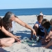 Anita Roth shows sea glass to children