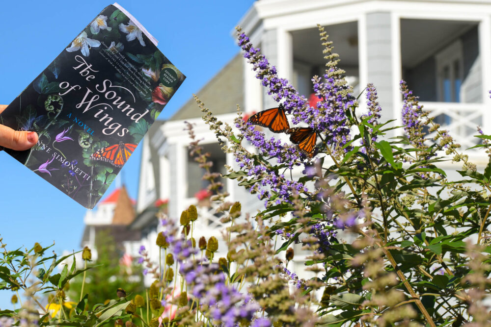 The Sound Of Wings book over a butterfly garden