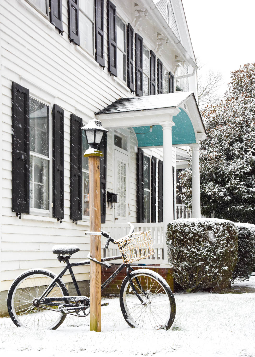 A bicycle in the snow on Hughes Street