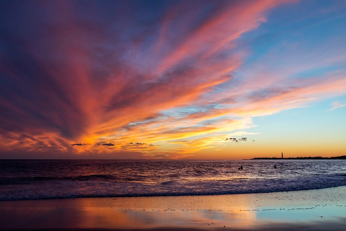 Colorful clouds in the sky and colors reflected in the shoreline