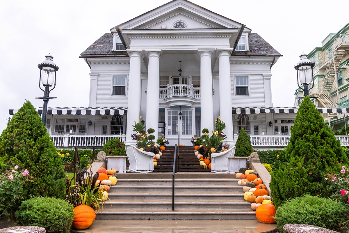 Pumpkins leading up a staircase to Peter Sheilds Inn