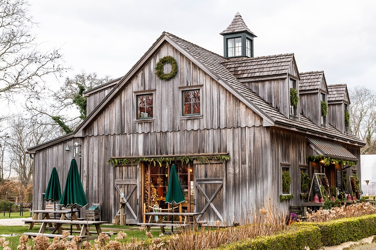 Holiday evergreen decorations at Beach Plum Farm with a Christmas tree in the window