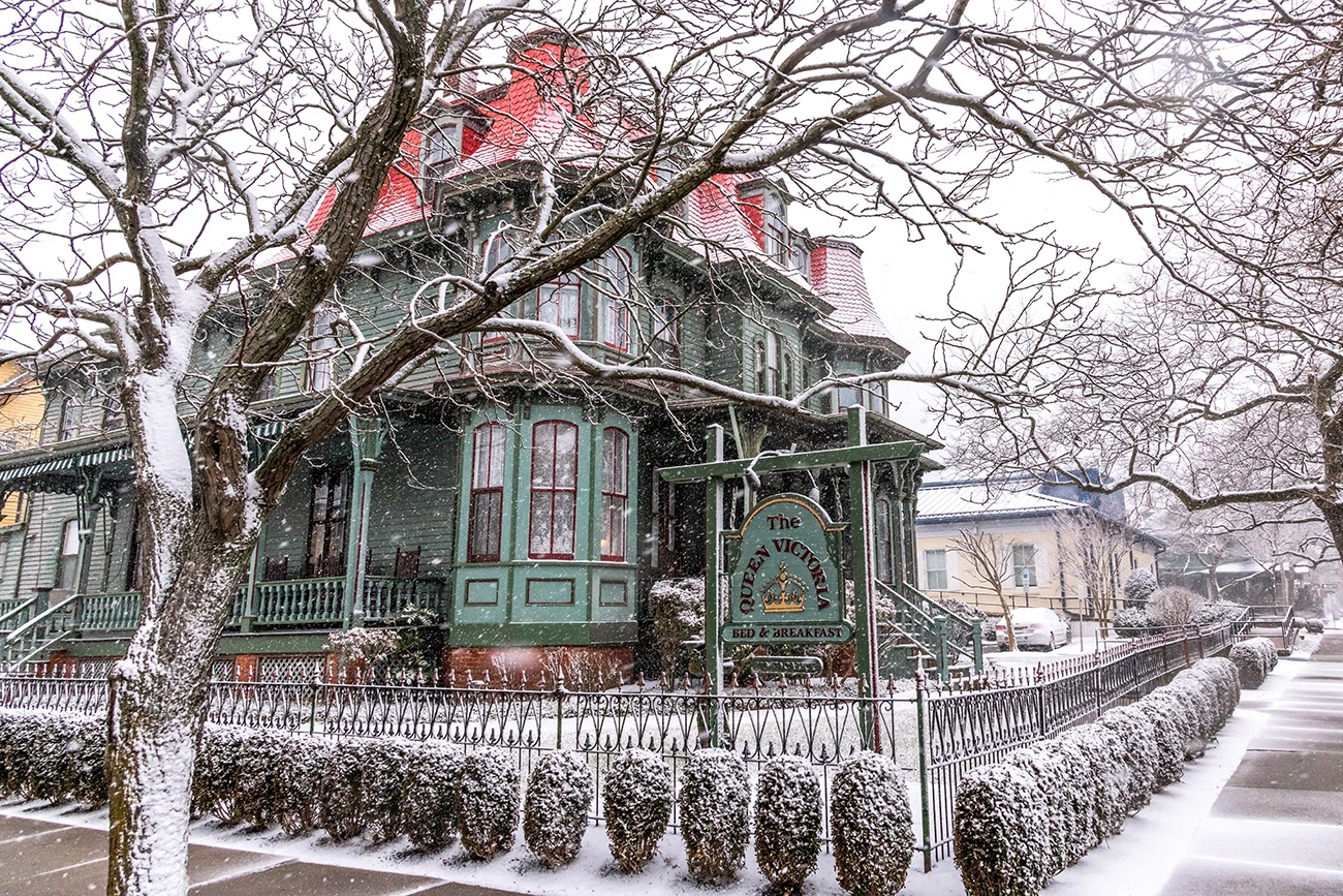 Snow falling on The Queen Victoria, a Victorian style bed and breakfast