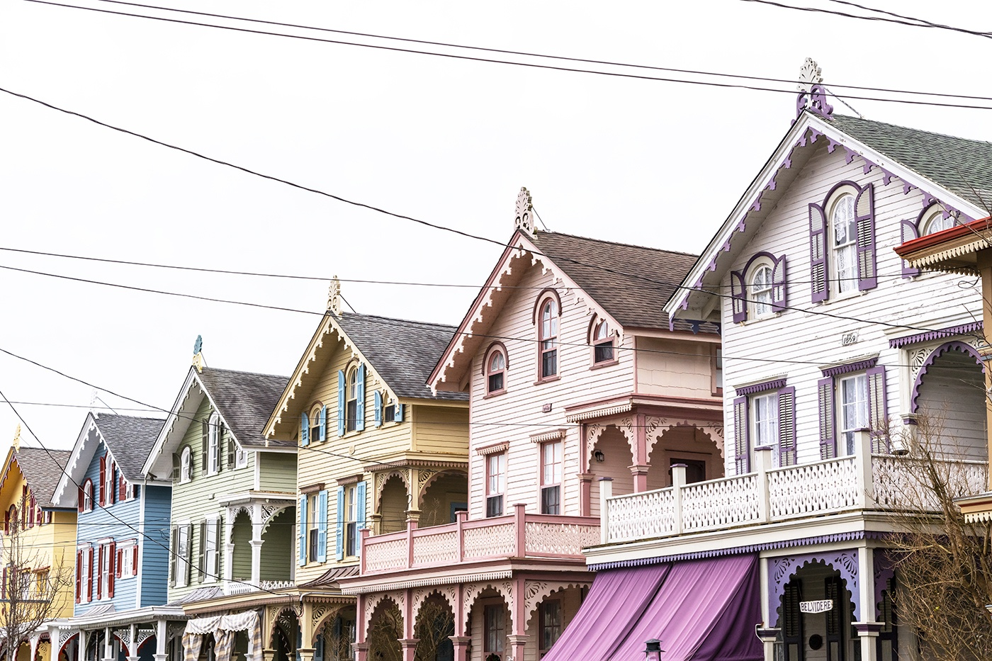 The tops of colorful Victorian houses in a row.