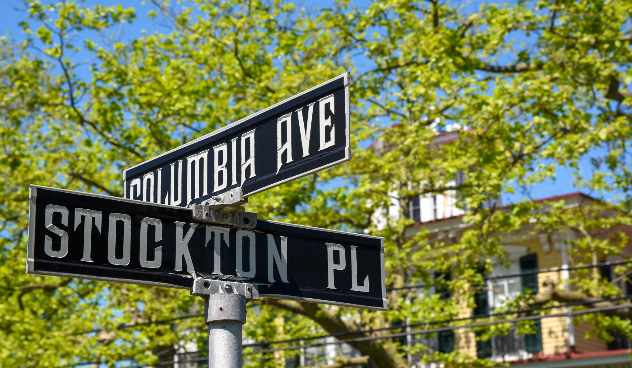 Stockton on the corner of Place & Columbia Avenue looking at the street signs