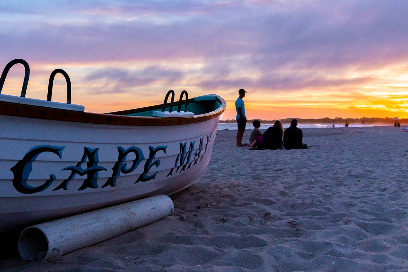 Close up view of a Cape May lifeguard boat with a colorful sunset in the background