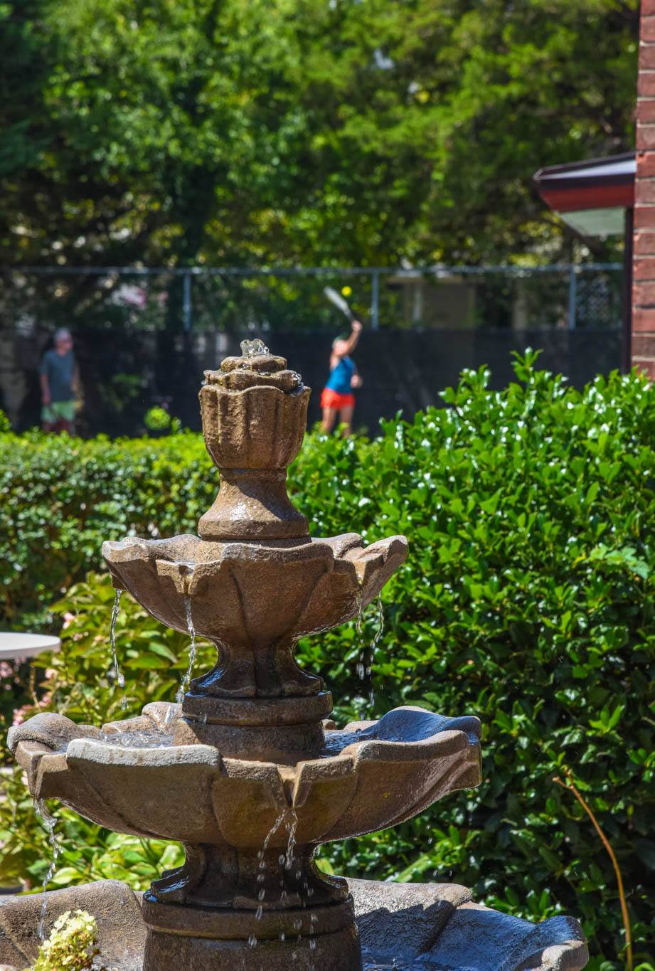 A fountain at The William J. Moore Tennis Center