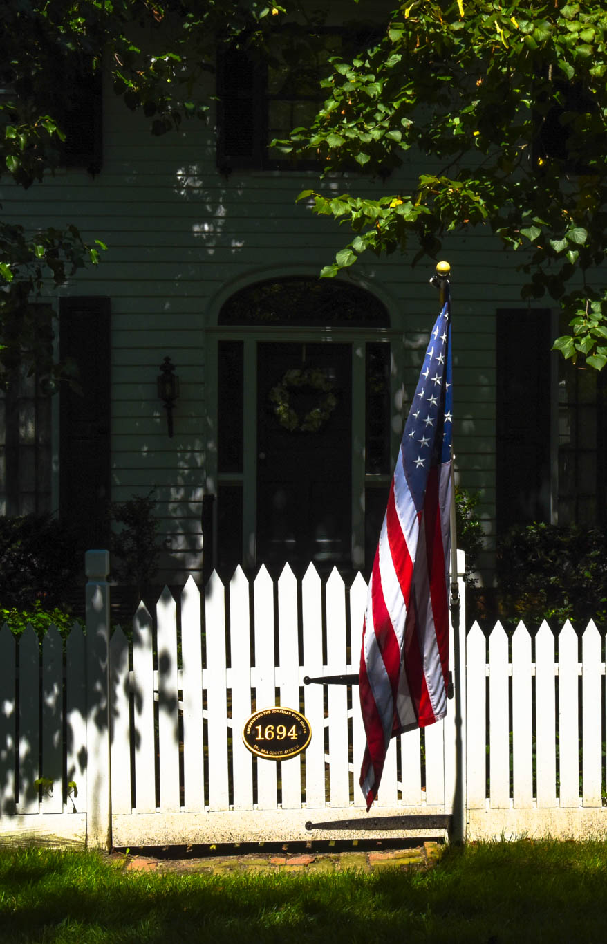 Sunny With A little Shade showing the American Flag on a fence in West Cape May