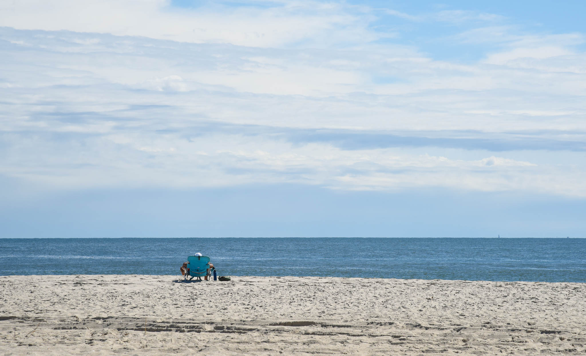 One person on the beach in a chair